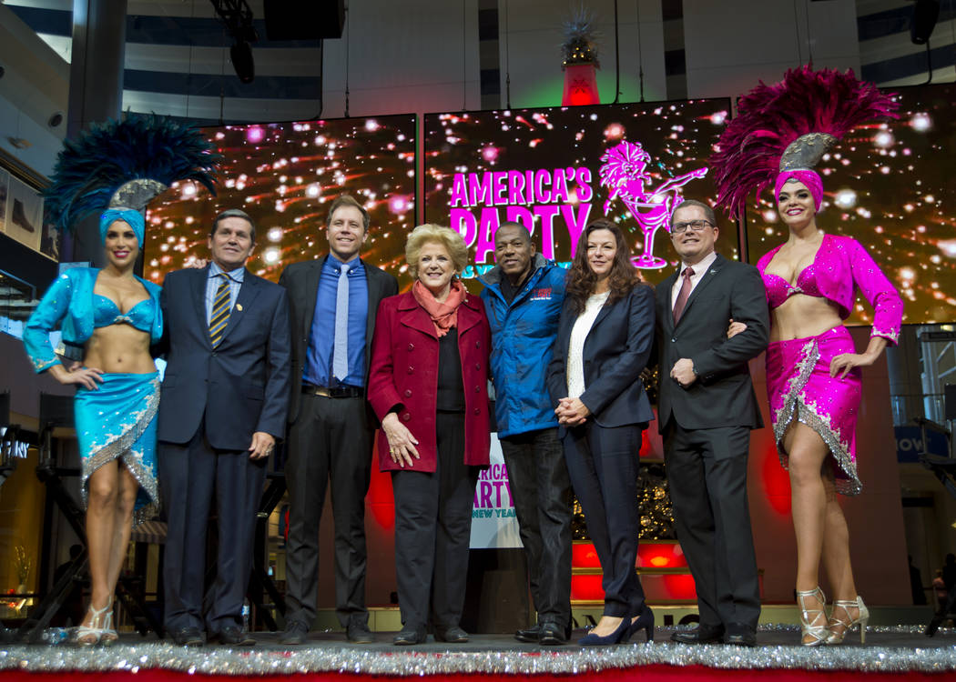 Las Vegas and Clark County officials and others pose for a photograph at the conclusion of the America's Party news conference announcing details of Las Vegas New Year's Eve celebrations inside th ...