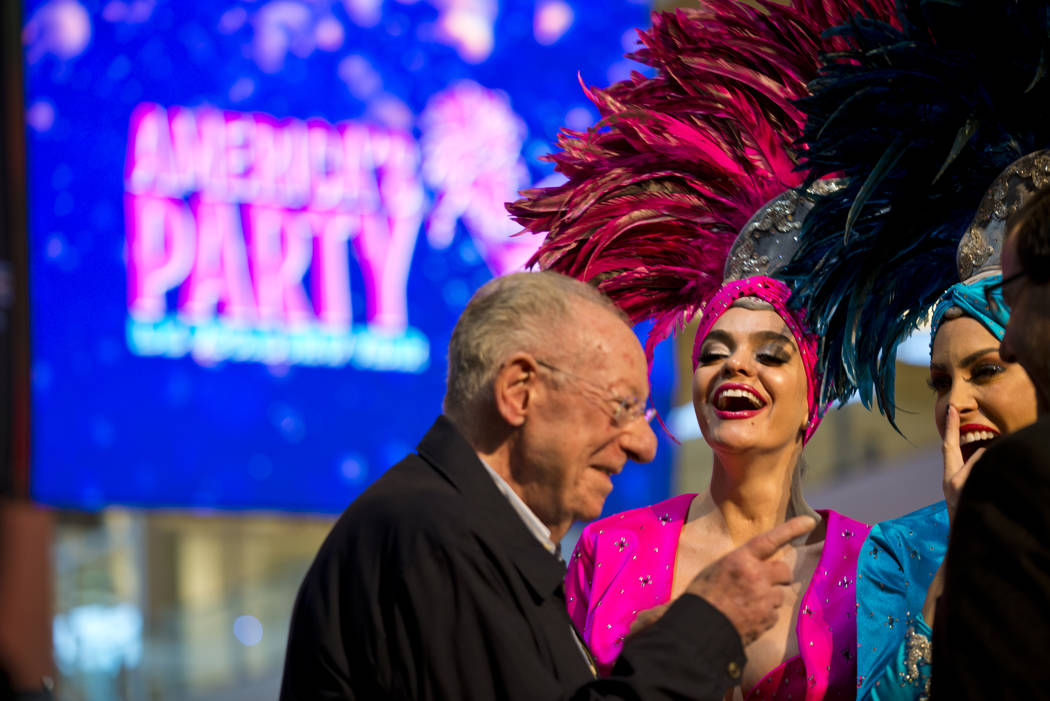 Former Las Vegas Mayor Oscar Goodman speaks with showgirls Porsha Revesz, center, and Jennifer Gagliano during the America's Party news conference announcing details of Las Vegas New Year's Eve ce ...