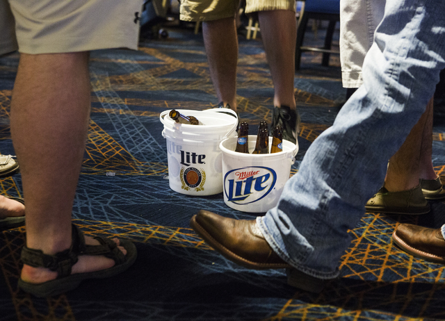 Buckets of beer sit on the floor while men gather at the William Hill Race & Sports Book in the Plaza Hotel-Casino on Friday, March 18,2016. Jeff Scheid/Las Vegas Review-Journal Follow @jlscheid