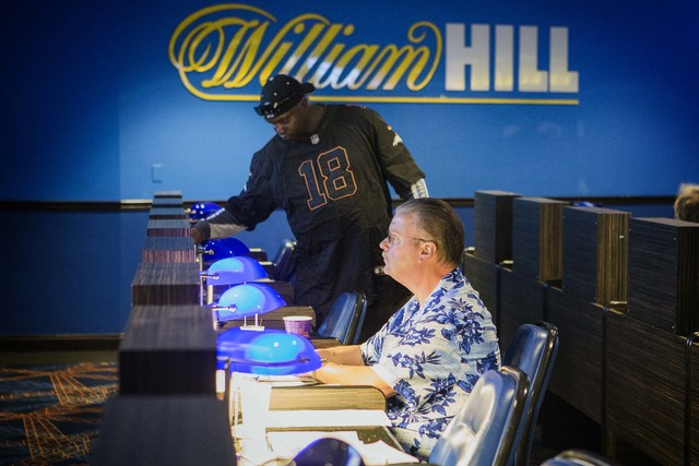 Steve Lewis, from Kansas City, watches a horse race on a TV monitor at the William Hill Race & Sports Book in The Plaza on Friday, March 18,2016. (Jeff Scheid/Las Vegas Review-Journal Follow @ ...