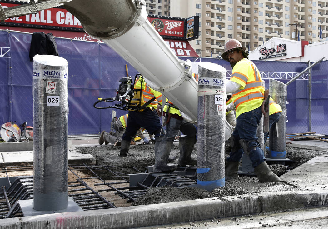 Construction crews pour cement where they began installing steel posts on the Strip near Aria on Monday, Nov. 13, 2017, to protect pedestrians along Las Vegas Boulevard. (Bizuayehu Tesfaye/Las Veg ...