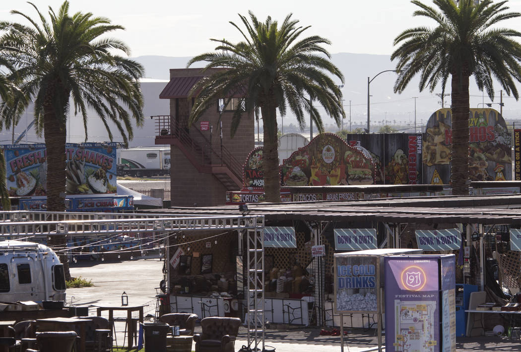A row of vendor booths and food stands sit frozen in time at the Route 91 Harvest shooting site at Las Vegas Village festival grounds, Tuesday, Oct. 31, 2017. Richard Brian Las Vegas Review-Journa ...