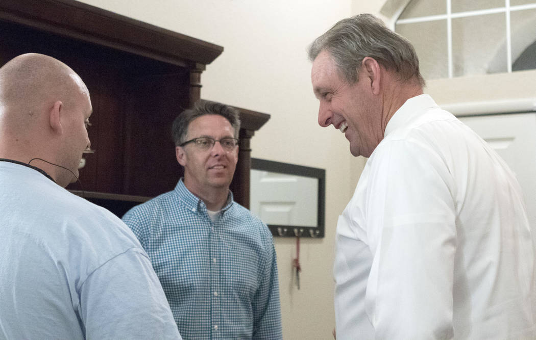 Mayor of North Las Vegas John Lee, right, who is running for a second term, speaks with North Las Vegas city council nominee Scott Black, center, and his campaign manager Zachary Guymon as they wa ...