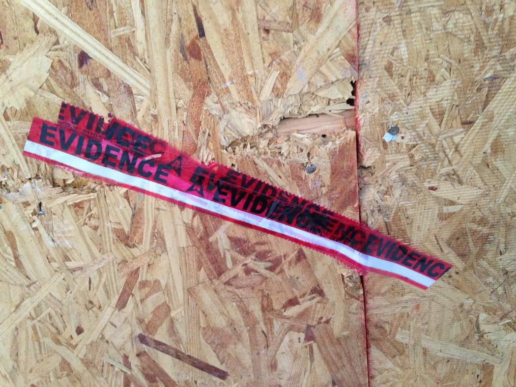 """Red tape marked """"Evidence"""" is fastened to the boarded-up garage of Las Vegas Strip gunman Stephen Paddock's house in Mesquite, as seen on Monday, Nov. 13, 2017. (Eli Segall/Las Vegas Review-Journal)"""