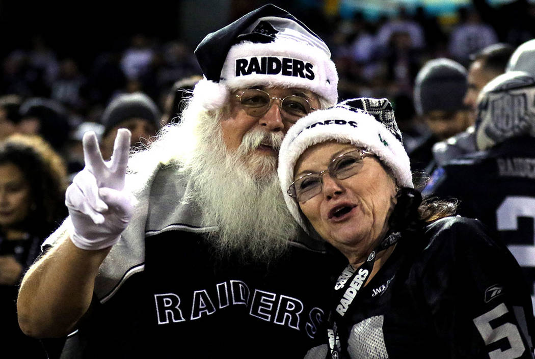 An Oakland Raiders fan is dressed like Santa Claus during the first half of a NFL game against the Dallas Cowboys in Oakland, Calif., Sunday, Dec. 17, 2017. Heidi Fang Las Vegas Review-Journal @He ...