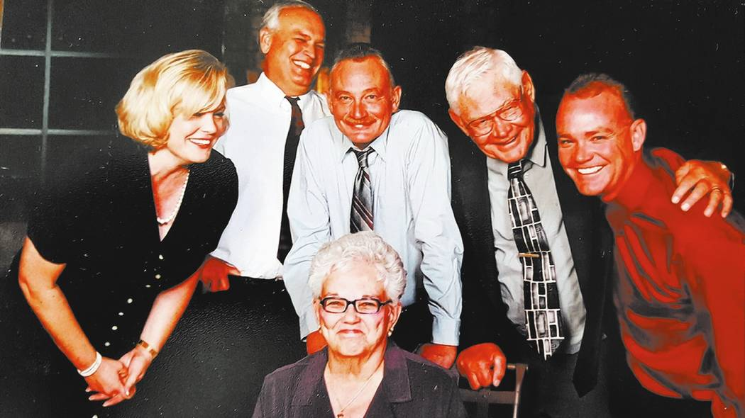 Kathy Cassell, her parents Carl and Kay Cassell, and her three brothers are pictured on her parents' 50th wedding anniversary in a favorite family photo taken in 2004. Her brothers, left to right  ...