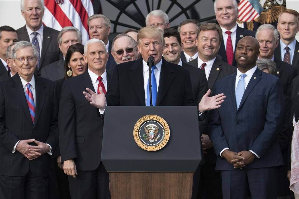 President Donald Trump joined by Senate Majority Leader Mitch McConnell of Ky., Vice President Mike Pence, Speaker of the House Paul Ryan, R-Wis., Sen. Tim Scott, R-S.C., front right, and other me ...