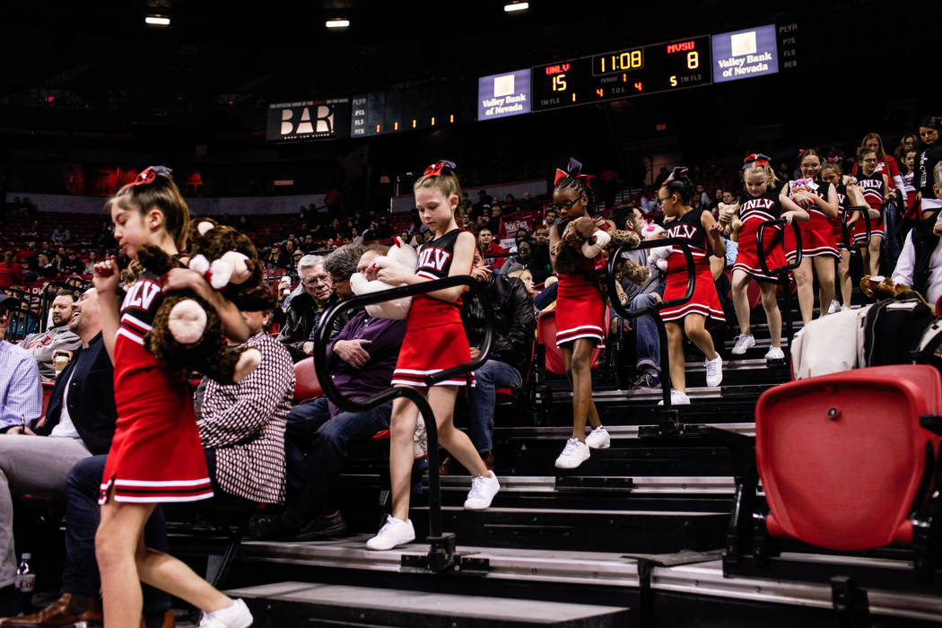 Cheerleaders from the Rebel Starzz walk down an aisle during the first half of a basketball between the UNLV Rebels and the Mississippi Valley State Delta Devils before the Annual Teddy Bear Toss  ...
