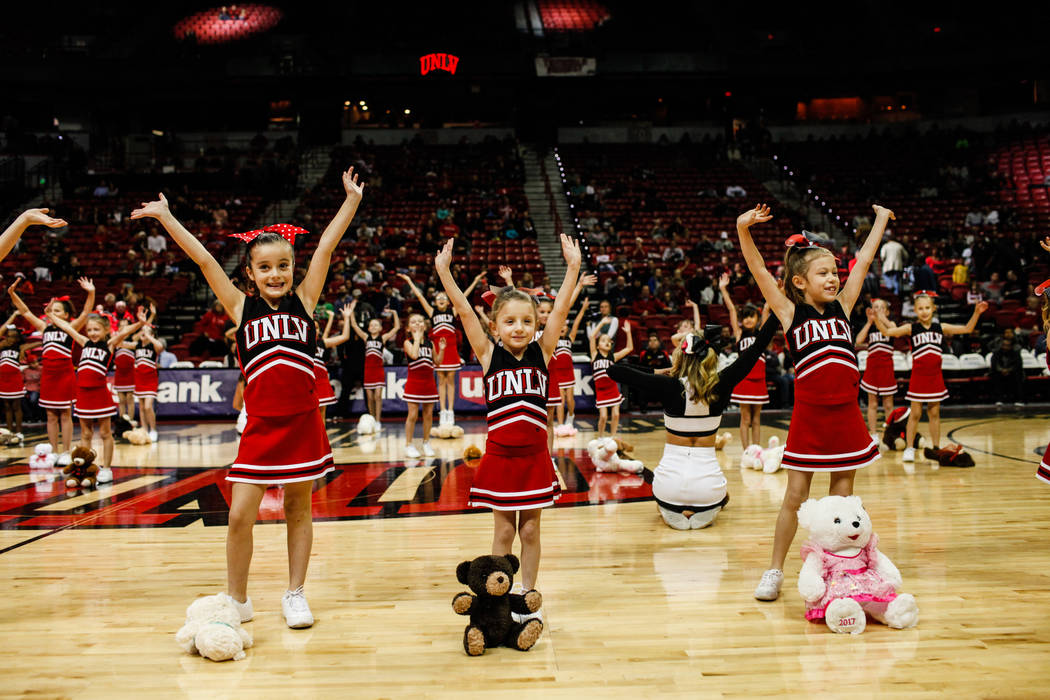 Rebel Starzz Cheer and Dance program cheerleaders dance introducing the 2nd Annual Teddy Bear Toss during half-time of the UNLV Rebels and Mississippi Valley State Delta Devils basketball game at  ...