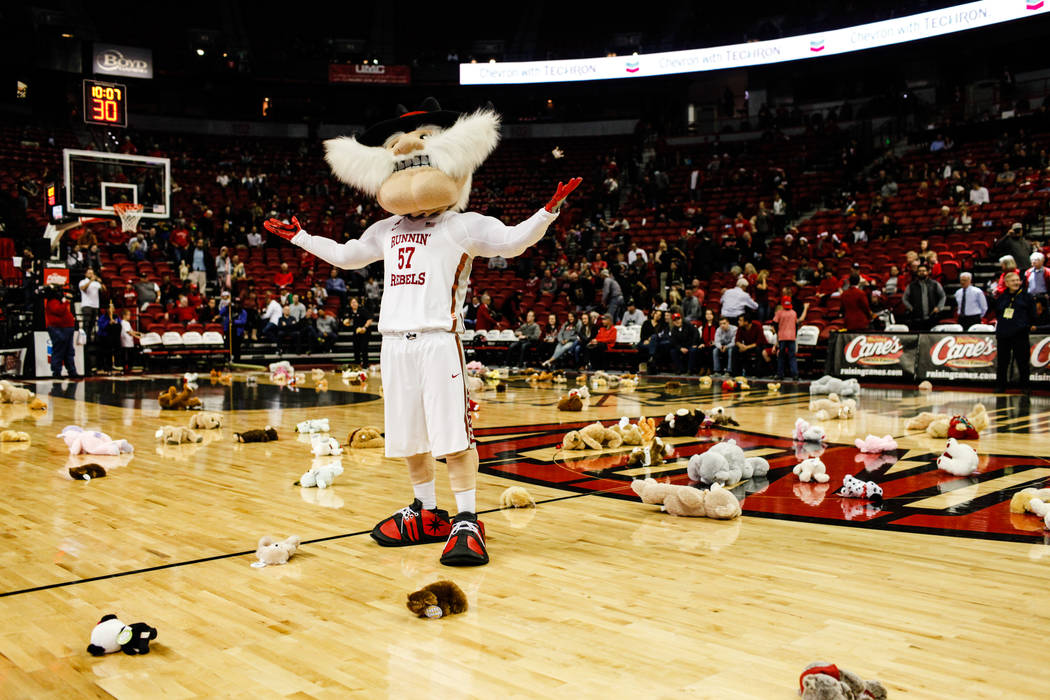 UNLV Rebels mascot stands in the middle of the basketball court as stuffed animals are thrown during the 2nd Annual Teddy Bear Toss during half-time of the UNLV Rebels and Mississippi Valley State ...