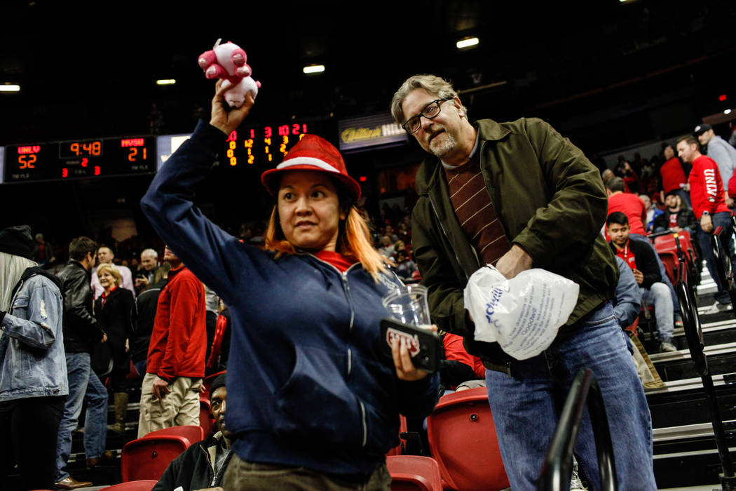 Fans throw stuffed animals onto the court during the 2nd Annual Teddy Bear Toss during half-time of the UNLV Rebels and Mississippi Valley State Delta Devils basketball game at the Thomas & Ma ...