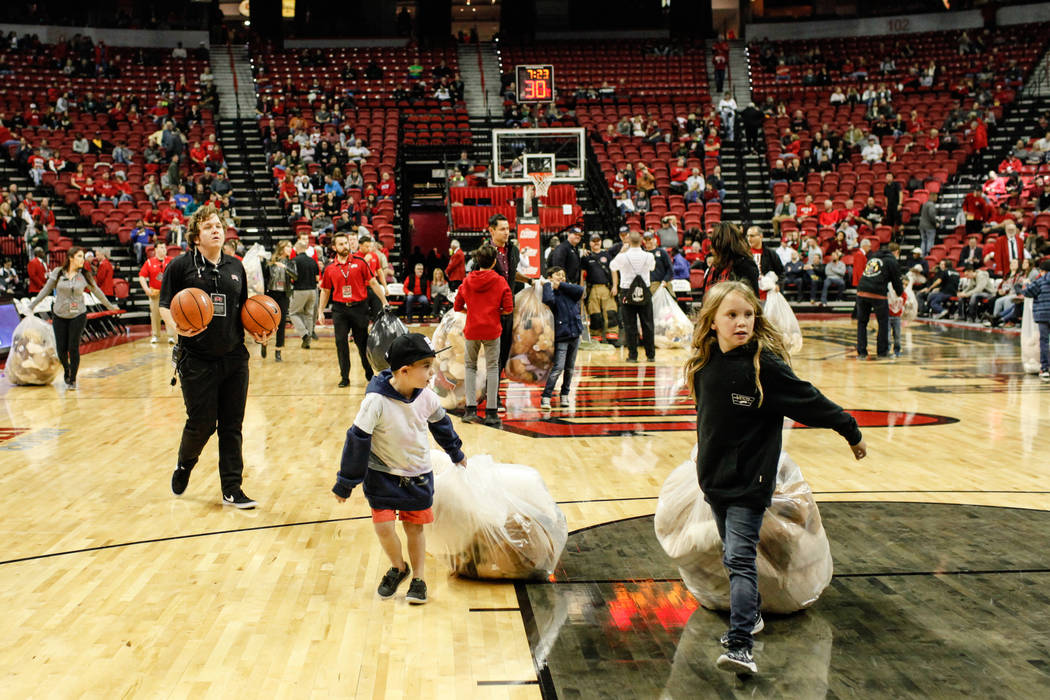 Children carry bags full of stuffed animals during the 2nd Annual Teddy Bear Toss during half-time of the UNLV Rebels and Mississippi Valley State Delta Devils basketball game at the Thomas &  ...