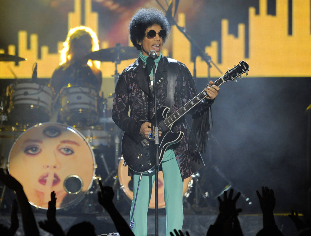 In this May 19, 2013 file photo, Prince performs at the Billboard Music Awards at the MGM Grand Garden Arena in Las Vegas. (Chris Pizzello/Invision/AP, File)