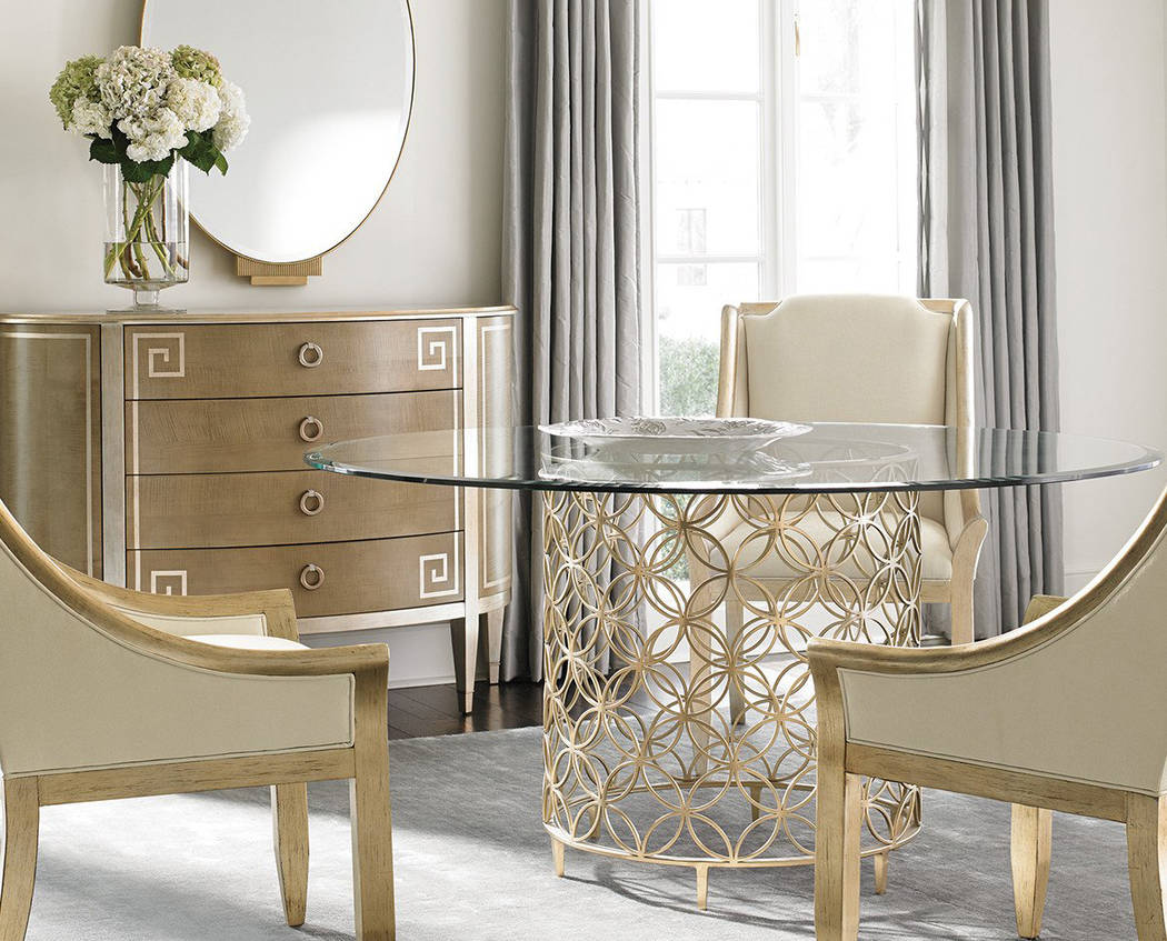 Soleil Design Gold leaf brings out carved details on a traditional piece of furniture