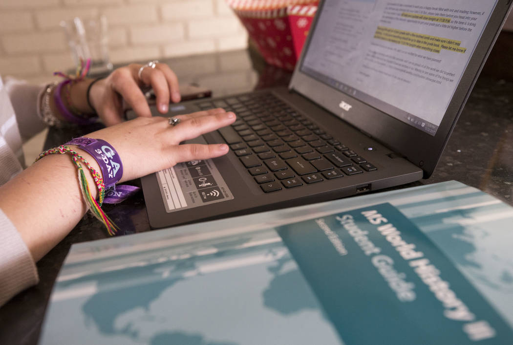 Route 91 survivor and eight-grader Francesca Trujillo, 13, logs into her Nevada Virtual Academy classroom at her Las Vegas home on Friday, Dec. 22, 2017. Richard Brian Las Vegas Review-Journal @ve ...
