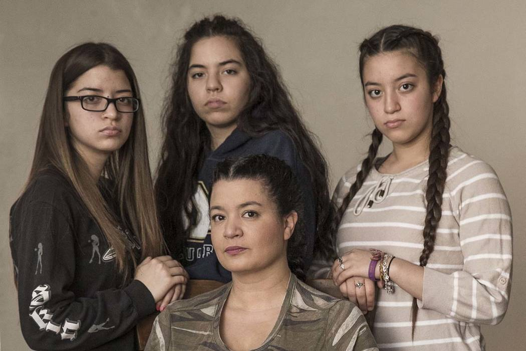 Route 91 survivors Sumer Henning, sitting, and her daughters, from left, Isabella, 15, Jacquelyn, 18, and Francesca, 13, at their Las Vegas home on Friday, Dec. 22, 2017. Richard Brian Las Vegas R ...