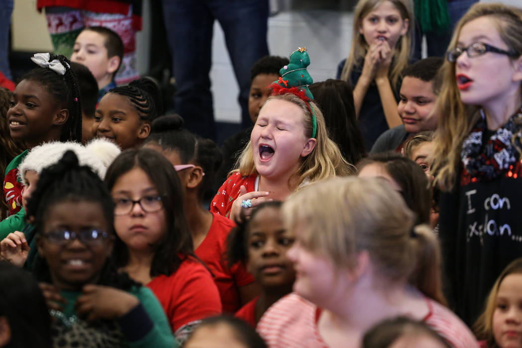 Students react as Santa Claus reveals gifts donated by Bob and Sandy Ellis at C. T. Sewell Elementary School in Henderson, Friday, Dec. 22, 2017. This is the 13th year that the couple has donated  ...