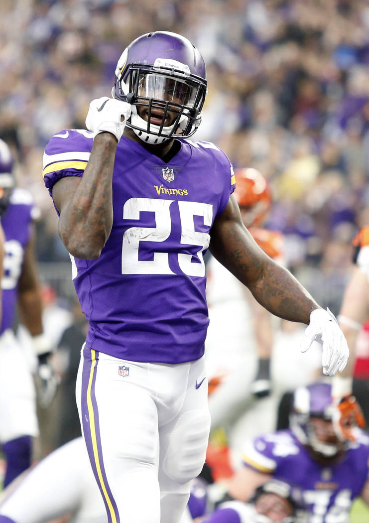 Minnesota Vikings running back Latavius Murray celebrates after scoring on a 1-yard touchdown run during the first half of an NFL football game against the Cincinnati Bengals, Sunday, Dec. 17, 201 ...