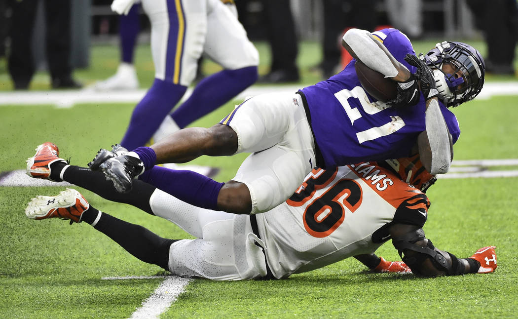 Minnesota Vikings running back Jerick McKinnon (21) is tackled by Cincinnati Bengals strong safety Shawn Williams during the first half of an NFL football game, Sunday, Dec. 17, 2017, in Minneapol ...
