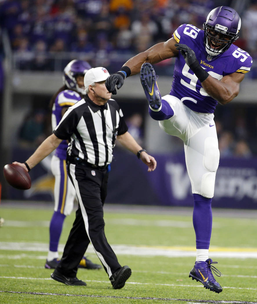 Minnesota Vikings defensive end Danielle Hunter (99) celebrates after sacking Cincinnati Bengals quarterback Andy Dalton during the first half of an NFL football game, Sunday, Dec. 17, 2017, in Mi ...