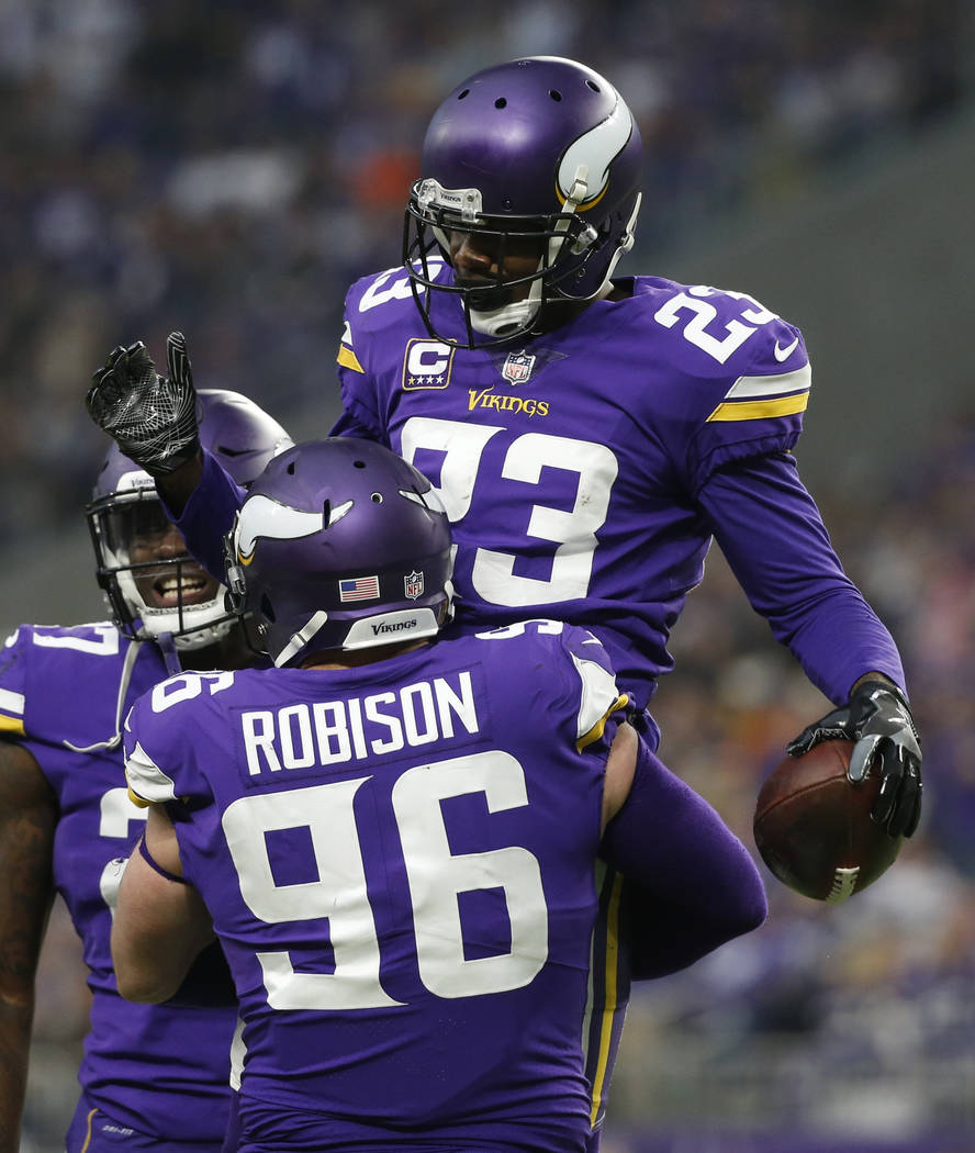 Minnesota Vikings cornerback Terence Newman (23) celebrates with teammate Brian Robison (96) after intercepting a pass during the second half of an NFL football game against the Cincinnati Bengals ...