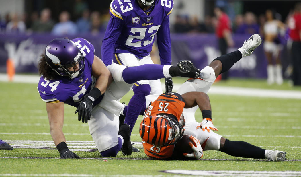 Cincinnati Bengals running back Giovani Bernard (25) is tackled by Minnesota Vikings middle linebacker Eric Kendricks (54) during the second half of an NFL football game, Sunday, Dec. 17, 2017, in ...