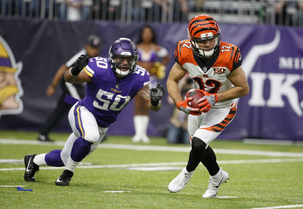 Cincinnati Bengals wide receiver Alex Erickson (12) runs from Minnesota Vikings linebacker Eric Wilson (50) during the first half of an NFL football game, Sunday, Dec. 17, 2017, in Minneapolis. (A ...