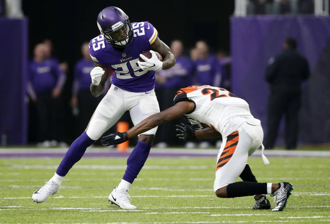 Minnesota Vikings running back Latavius Murray (25) runs from Cincinnati Bengals cornerback William Jackson during the first half of an NFL football game, Sunday, Dec. 17, 2017, in Minneapolis. (A ...