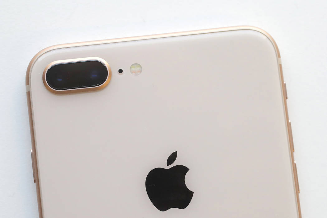FILE - In this Sept. 15, 2017, file photo, the camera, upper left, of an iPhone 8 Plus is displayed in New York. Apple Inc. reports earnings Thursday, Nov. 2, 2017. (AP Photo/Mark Lennihan, File)