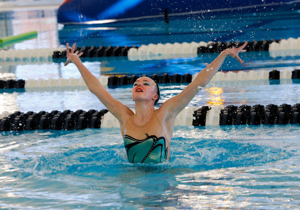 Natalie LaGrone, 17, of Nevada Desert Mermaids, a competitive synchronized swim team, performs during the grand opening of 24,940-square-foot Aquatic Springs indoor pool in Las Vegas, Thursday, De ...