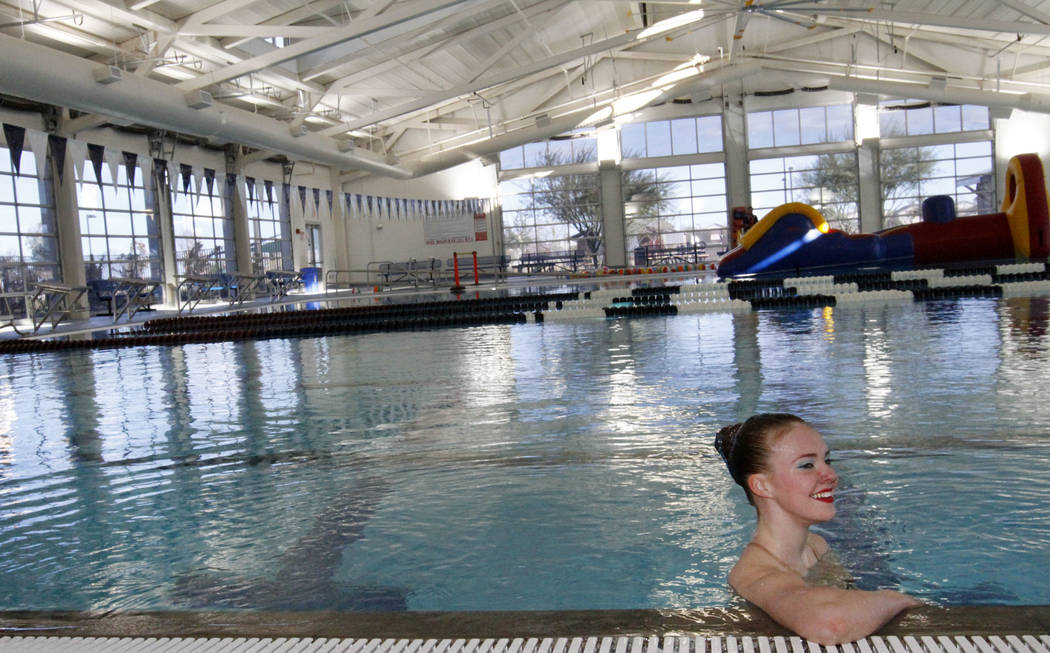 Natalie LaGrone, 17, of Nevada Desert Mermaids, a competitive synchronized swim team, after performing at the grand opening of 24,940-square-foot Aquatic Springs indoor pool in Las Vegas, Thursday ...