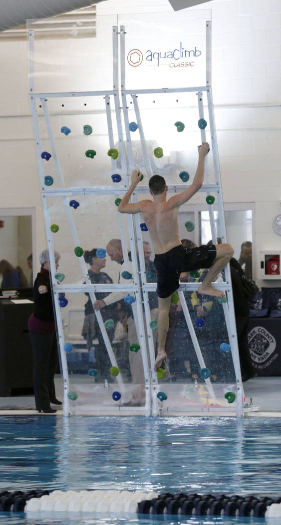 A staff member demonstrates rock climbing during the grand opening of 24,940-square-foot Aquatic Springs indoor pool in Las Vegas, Thursday, Dec. 21, 2017. Chitose Suzuki Las Vegas Review-Journal