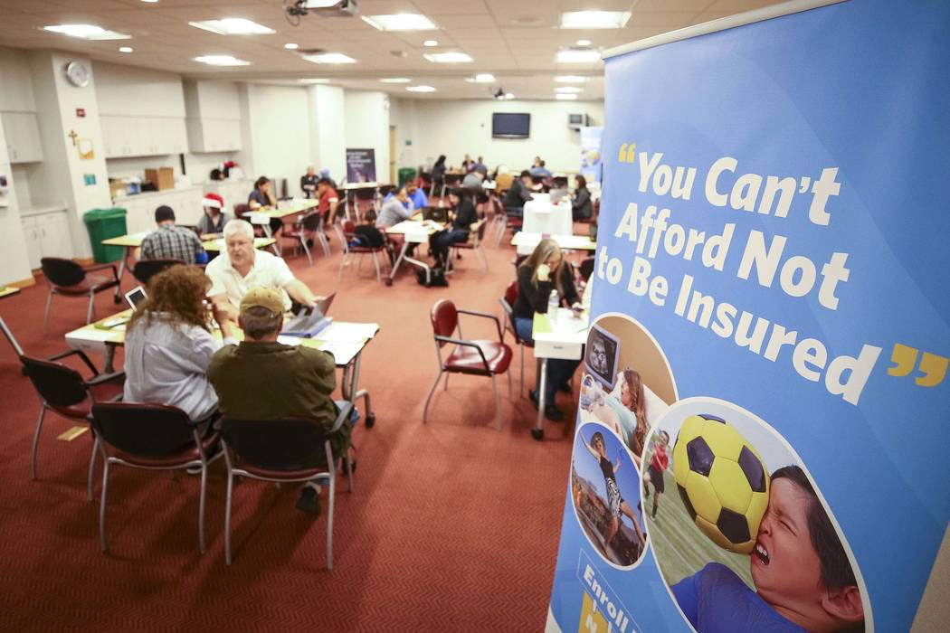 People sign up for the exchange during an open enrollment event for the Nevada Health Link at St. Rose Dominican Hospital San Martin Campus, Friday, Dec. 14, 2017, in Las Vegas. (Richard Brian/Las ...