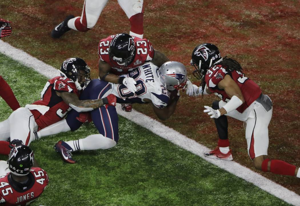 New England Patriots' James White scores the winning touchdown during overtime of the NFL Super Bowl 51 football game against the Atlanta Falcons, Sunday, Feb. 5, 2017, in Houston. (AP Photo/Charl ...