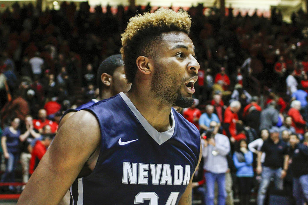 Nevada's Jordan Caroline (24) celebrates his team's win following the end of an NCAA college basketball game against New Mexico in Albuquerque, N.M., Saturday, Jan. 7, 2017. Nevada won in overtime ...