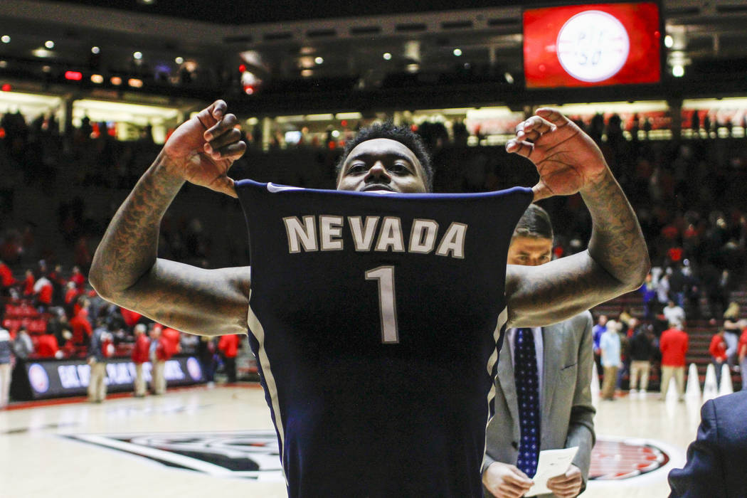 Nevada's Marcus Marshall (1) celebrates his team's win following the end of an NCAA college basketball game against New Mexico in Albuquerque, N.M., Saturday, Jan. 7, 2017. Nevada won in overtime  ...