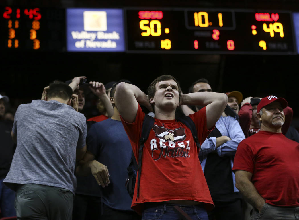 UNLV fans react as the team begins to trail San Diego State in the final moments of the second half during a Mountain West Conference tournament basketball game at the Thomas & Mack Center in  ...