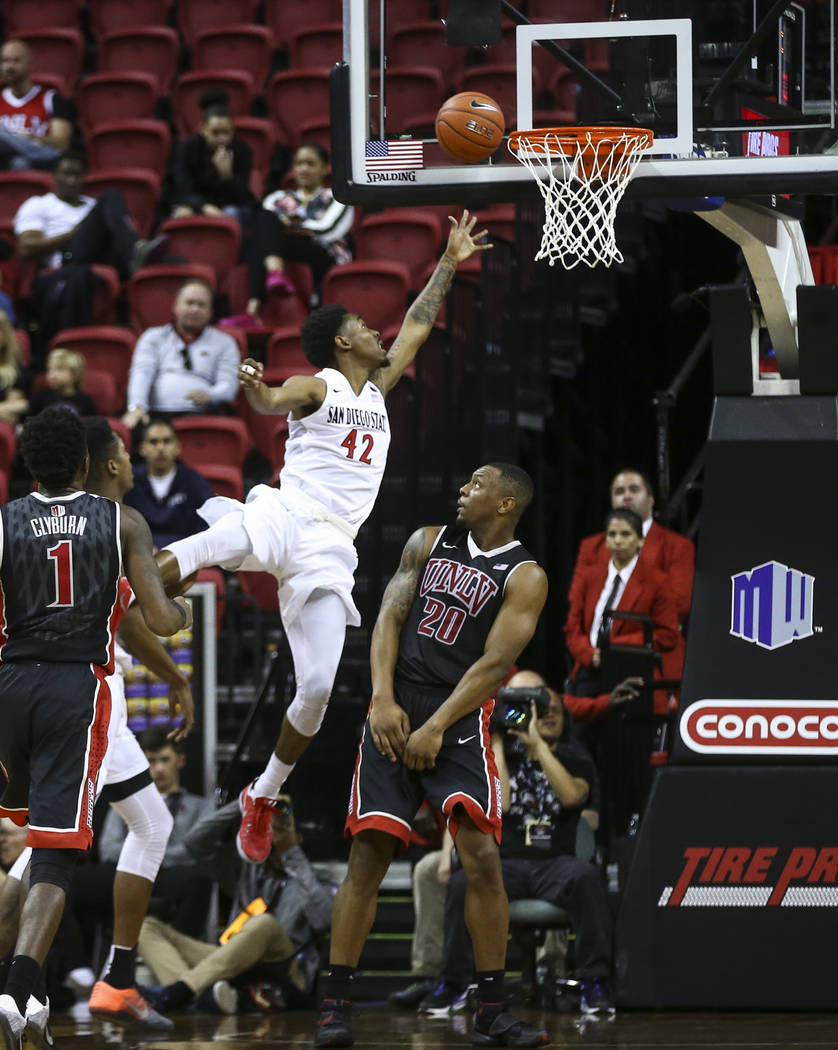 San Diego State guard Jeremy Hemsley (42) goes to the basket over UNLV forward Christian Jones (20) during a Mountain West Conference tournament basketball game at the Thomas & Mack Center in  ...
