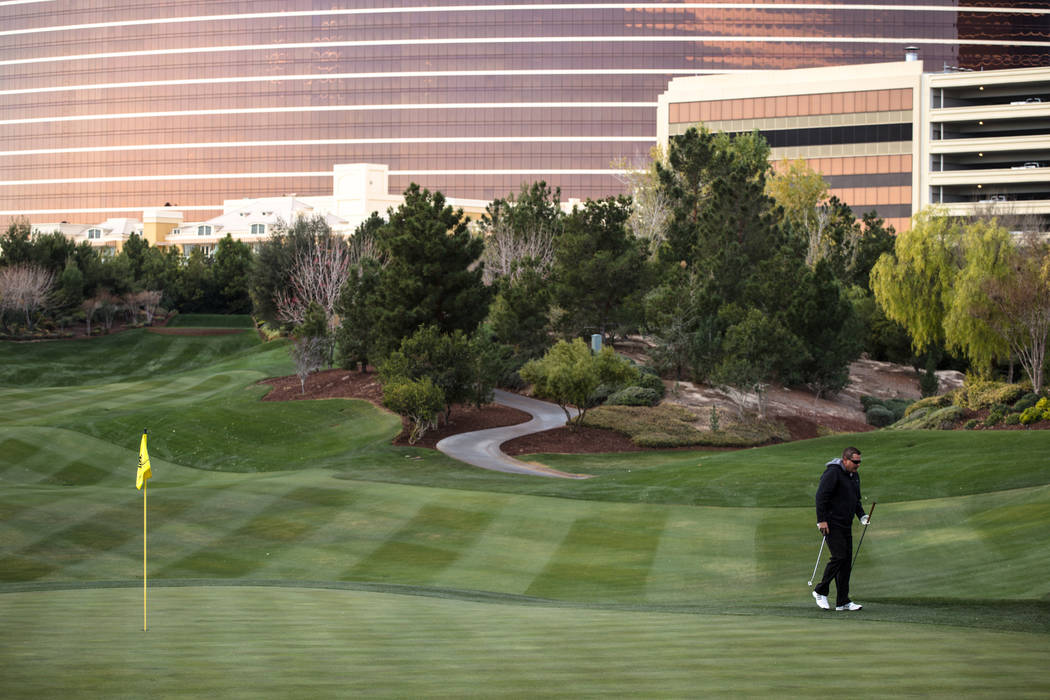Wynn Las Vegas employee Mike Barrett, 45, golfs at the Wynn Country Club in Las Vegas, Friday, Dec. 22, 2017. The golf course is shutting down on Dec. 23 and will be replaced with Paradise Park, a ...