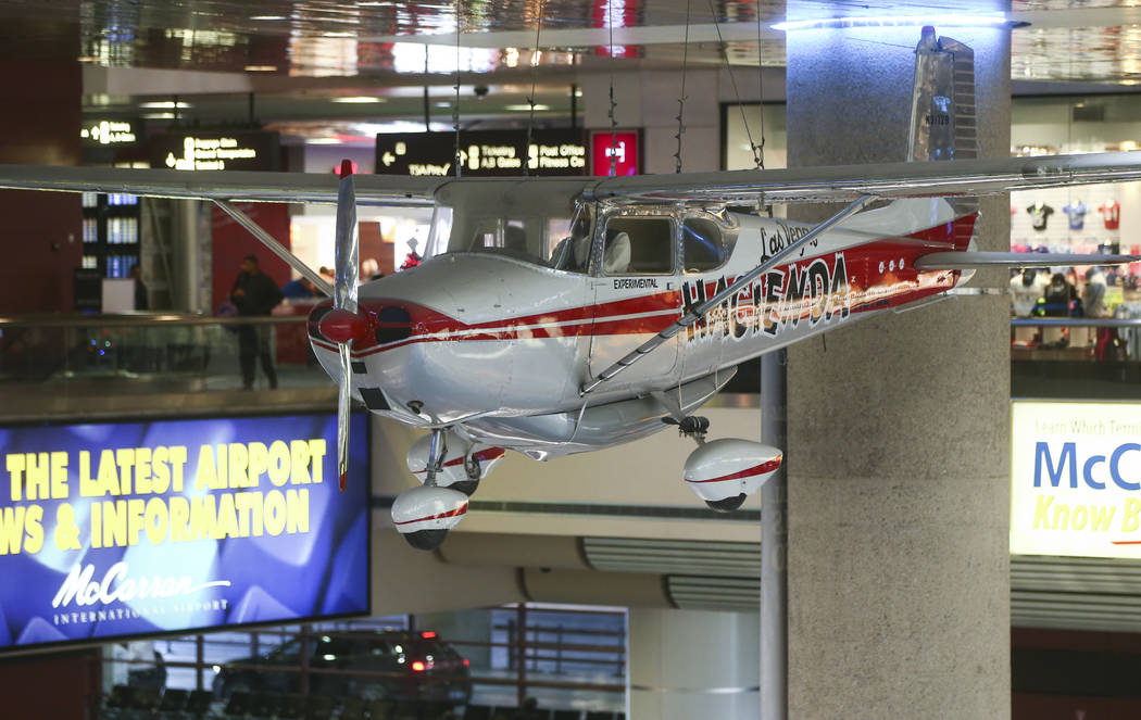 A 1958 Cessna 172 single-engine plane, part of the Howard W. Cannon Aviation Museum, hangs over the baggage claim at McCarran International Airport in Las Vegas on Tuesday, Dec. 26, 2017. Chase St ...