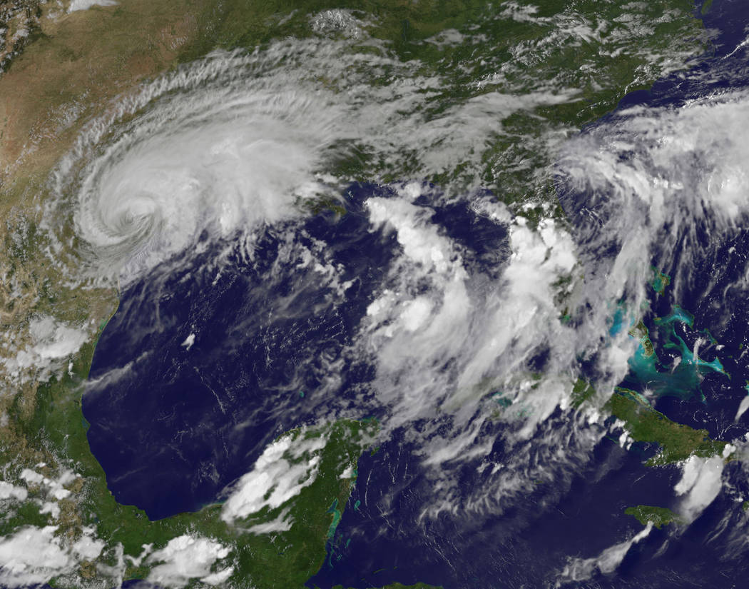 This enhanced satellite image made available by the NOAA GOES Project shows Harvey, upper left, over Texas on Saturday, Aug. 26, 2017 at 6:30 p.m. The remnants of the hurricane spun deeper into Te ...