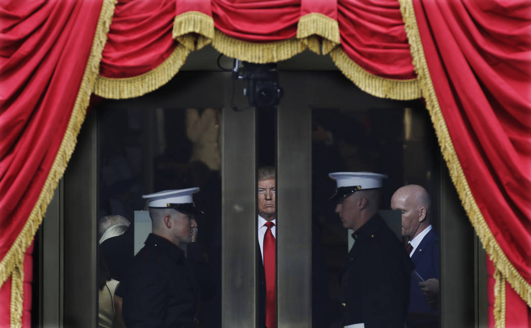 FILE - In this Jan. 20, 2017 file photo, President-elect Donald Trump waits to step out onto the portico for his Presidential Inauguration at the U.S. Capitol in Washington. (AP Photo/Patrick Sema ...