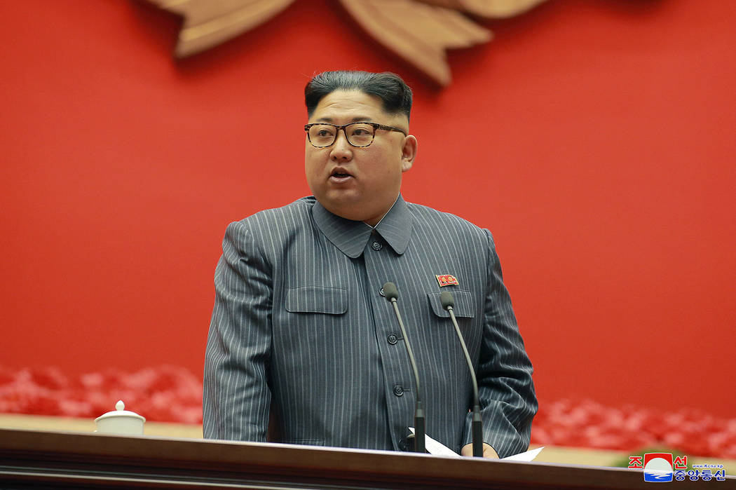 In this Dec. 23, 2017, photo distributed on Dec. 24, 2017, by the North Korean government, North Korean leader Kim Jong Un speaks during the conference of cell chairpersons of the ruling party in  ...