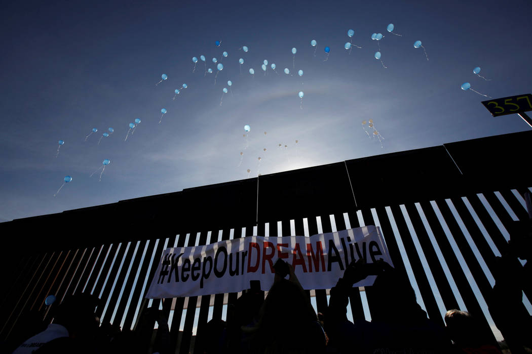 'Dreamers' meet with relatives as they release balloons during the 'Keep Our Dream Alive' binational meeting at a new section of the border wall on the U.S.-Mexico border in Sunland Park, U.S., op ...
