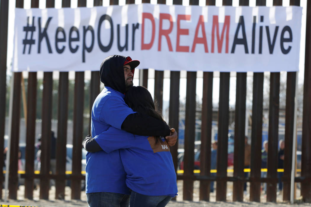 'Dreamers' hug as they meet with relatives during the 'Keep Our Dream Alive' binational meeting at a new section of the border wall on the U.S.-Mexico border in Sunland Park, U.S., opposite the Me ...