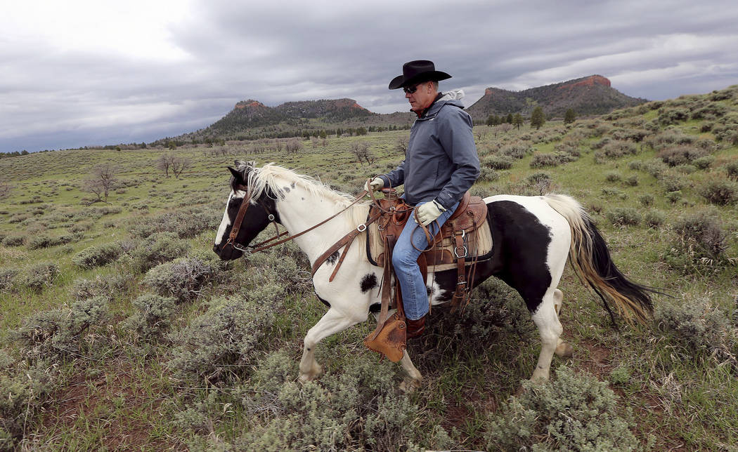 FILE - In this May 9, 2017, file photo, Interior Secretary Ryan Zinke rides a horse in the new Bears Ears National Monument near Blanding, Utah. Utah has long stood out for going far beyond other  ...