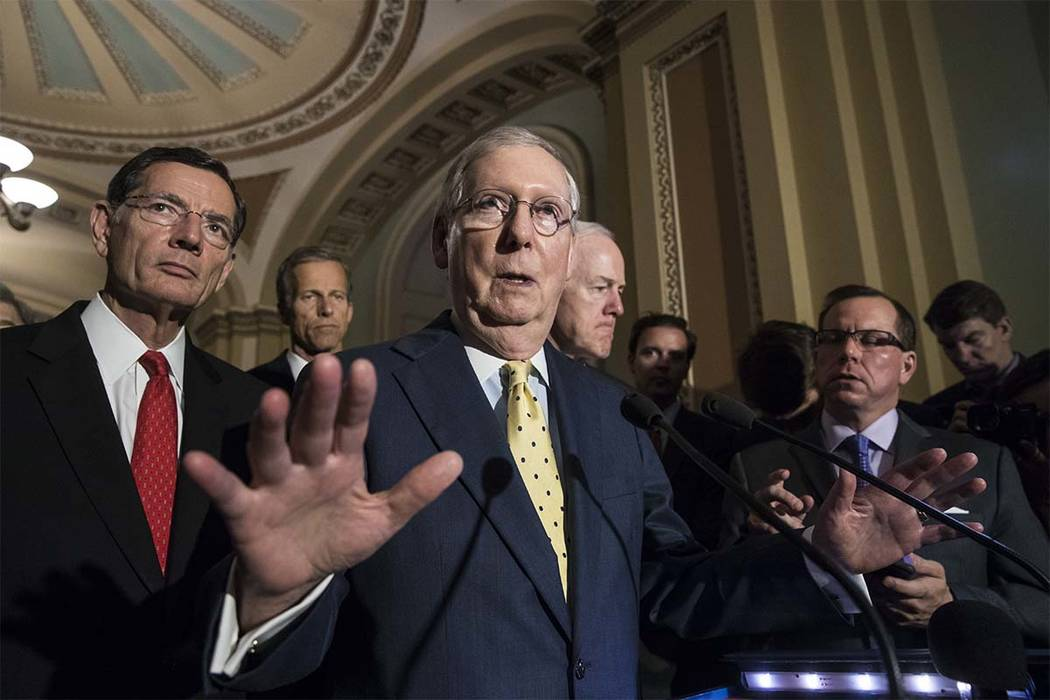 Senate Majority Leader Mitch McConnell, R-Ky., joined by, from left, Sen. John Barrasso, R-Wyo., Sen. John Thune, R-S.D., and Majority Whip John Cornyn, R-Texas, speaks following a closed-door str ...