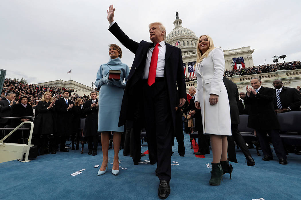 U.S. President Donald Trump acknowledges the audience after taking the oath of office as his wife Melania (L) and daughter Tiffany watch during inauguration ceremonies swearing in Trump as the 45t ...