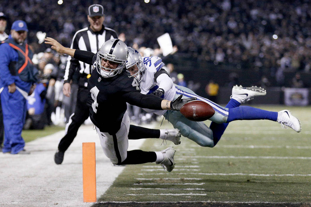 Dec 17, 2017; Oakland, CA, USA; Oakland Raiders quarterback Derek Carr (4) fumbles the ball out of the end zone against the Dallas Cowboys in the fourth quarter at Oakland Coliseum. Mandatory Cred ...