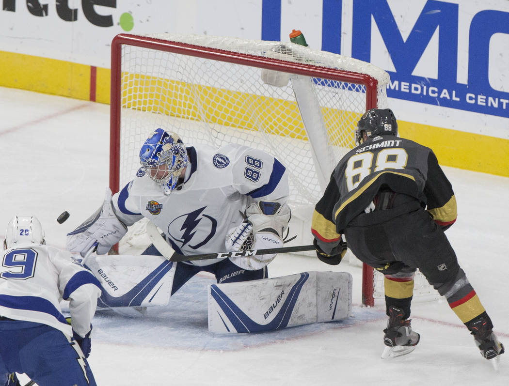 Tampa Bay goaltender Andrei Vasilevskiy (88) makes a save against Golden Knights defenseman Nate Schmidt    (88) in the second period during the Lightning's road matchup with Vegas on Tuesday, Dec ...